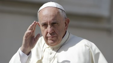 Taking stand on climate change: Pope Francis waves as he arrives for his weekly general audience, in St Peter's Square at the Vatican.
