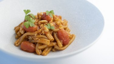 Casarecce pasta with spanner crab, roast cherry tomato and spicy prawn oil.