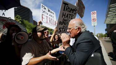John Coulthard (right), a supporter of Donald Trump, argues with demonstrators outside a Trump campaign event in Phoenix, Arizona, last week.