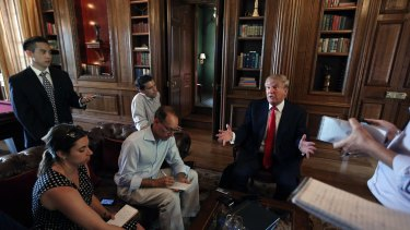 Donald Trump answers questions about his bid for the US presidency in Albemarle House, a property of his outside of Charlottesville, Virginia, on Tuesday.