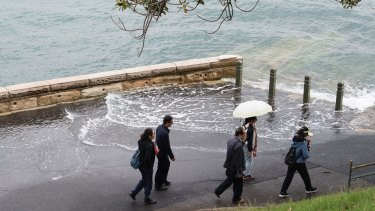 The footpath was also flooded at Mrs Macquarie Point.