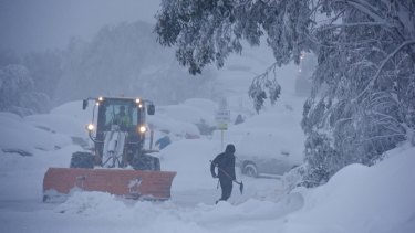 Crews at Falls Creek after heavy snow fell on Sunday.