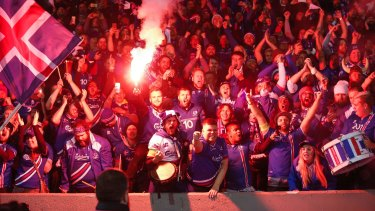 Delirious Iceland fans celebrate their team's victory against Kosovo.
