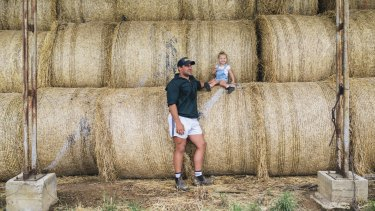 Brumbies hooker Josh Mann-Rea with daughter Avery at their home in Jugiong. He drives 90 minutes to Canberra for Super Rugby training every day.
