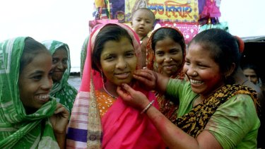 Village girls prepare a young bride (centre) for her wedding near the Bangladesh capital of Dhaka.
