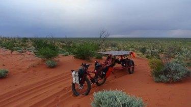 Sam's bike in the red sand.