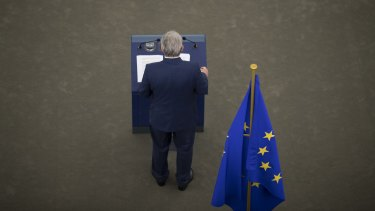 Jean-Claude Juncker stands at a podium as he delivers his state of the union speech at the European Parliament in Strasbourg, France.