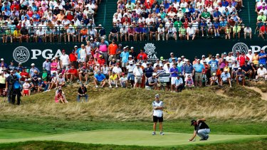 Packed gallery: Jason Day lines up a putt on the sixth hole during the final round of the 2015 PGA Championship at Whistling Straits.