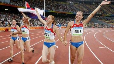 (From right) Russia's Yuliya Chermoshanskaya (right), Aleksandra Fedoriva, Yulia Gushchina and Evgeniya Polyakova celebrate winning gold in the 4x100 final in Beijing in 2008.