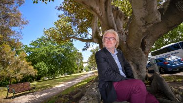 Dave Kendal under a Morton Bay Fig tree, a species which could become more abundant in a warmer Melbourne.