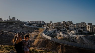 The separation wall snakes around Shuafat in occupied East Jerusalem. Here as in Kufr Aqab further north, the wall's route has created anomalous living conditions for Palestinians.