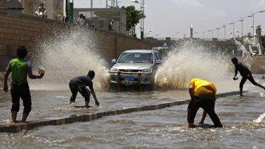 Boys play in floodwaters after heavy rain in Sanaa last week.
