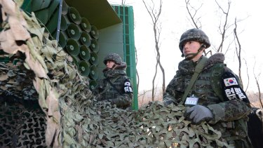South Korean army soldiers remove camouflage from the loudspeakers near the border to resume broadcasts of anti-Pyongyang propaganda.