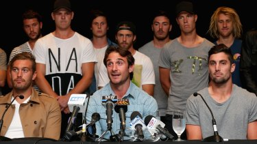 Jobe Watson and Essendon teammates at a press conference after they were cleared by the AFL anti-doping tribunal in March 2015.