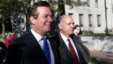 Paul Manafort, left, leaves the Federal District Court in Washington on Monday after pleading not guilty.