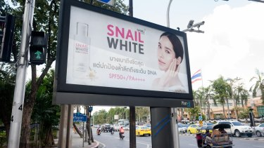 Skin whitening products advertised in Bangkok.