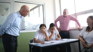"""""""I've been in NSW, Victorian and Western Australian schools, I've seen excellent schools,"""" says Sahlberg (right) after visiting sites with then education minister Adrian Piccoli."""