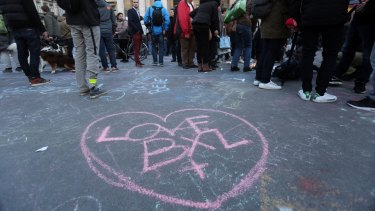 Love BXL written on the ground as people leave tributes at the Place de la Bourse in Brussels.