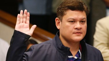 Paolo Duterte takes his oath in a continuing Senate probe into drug importation on September 7.