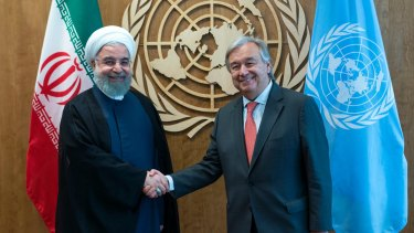 United Nations Secretary-General Antonio Guterres, right, greets Iranian President Hassan Rouhani.