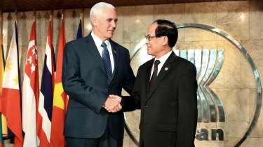 US Vice-President Mike Pence shakes hands with ASEAN Secretary-General Lee Luong Minh at the ASEAN Secretariat in Jakarta on Thursday.