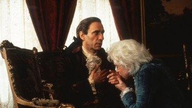 "F. Murray Abraham as ""old"" Antonio Salieri and Tom Hulce as Wolfgang Amadeus Mozart in Amadeus."