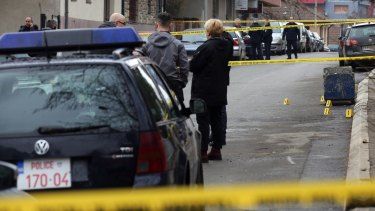 Police officers secure the scene where unknown assailants opened fire and killed Oliver Ivanovic.