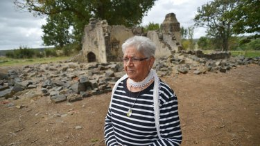 Laura Bell, Frederick Lovett's daughter, walks through the ruins at the Aborginal Mission station, Lake Condah. The five Lovett brothers lived here after returning from World War I.
