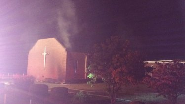 Smoke rises from Mount Zion African Methodist Episcopal church near Greeleyville, South Carolina, which caught fire Tuesday.