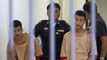 Myanmar workers Win Zaw Htun, right, and Zaw Lin, left, both 22, escorted by officials after they were convicted in December last year of the murder Hannah Witheridge and David Miller.