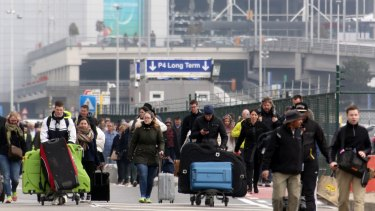 Passengers are evacuated from Brussels airport after the blast on Tuesday morning.