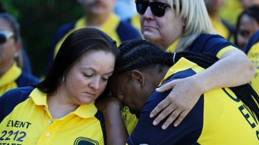 Kim Bartlett, left, comforts Cassandra Johnson before a funeral for their coworker Erick Silva, a security guard killed in the Las Vegas shooting.
