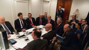 President Donald Trump receives a briefing on the Syria military strike from his National Security team at Mar-a-Lago after the strike.