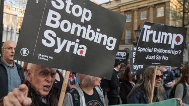 Protesters against the US strike at a Stop the War Coalition demonstration opposite Downing Street, London, on Friday.