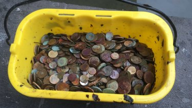 One of the buckets of coins retrieved from the fountain outside the National Gallery of Victoria.