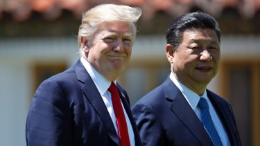 Donald Trump and Chinese President Xi Jinping walk together after their meetings at Mar-a-Lago in Florida.