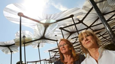 MPavilion founder Naomi Milgrom (left), and British architect Amanda Levete at the official opening of the MPavilion at Melbourne's Queen Victoria Gardens on Monday.