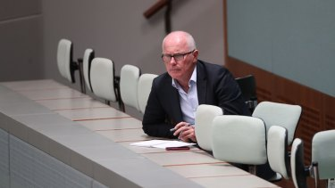 Veteran journalist Michael Gordon observes Question Time at Parliament House in Canberra.