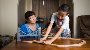 Nancy Ju and Allan Liang, 9, in their Chisholm home.