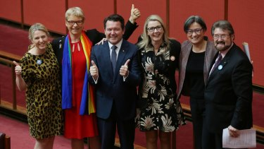 Senator Dean Smith with Senators Louise Pratt, Janet Rice, Skye Kakoschke-Moore, Penny Wong and Derryn Hinch after the introduction of the Marriage Amendment Bill on Wednesday.