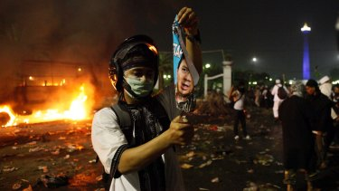 Protesters clash with police in central Jakarta.