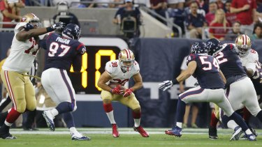 Switching codes: Jarryd Hayne rushes during last year's pre-season game against the Houston Texans.
