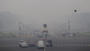 Smog and fog envelop morning traffic in New Delhi. India has forecast of higher carbon emissions as it boosts electricity output over the coming decades.
