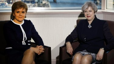 Britain's Prime Minister Theresa May, right, and Scotland's First Minister Nicola Sturgeon