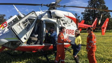 NSW SES volunteers deliver food and supplies to the Alcorn family on their property in Jemalong.