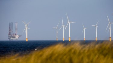 A jack-up rig stands near to Teesside Offshore Wind Farm, near Hartlepool in the UK.