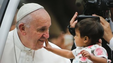 Pope Francis and an admirer in Philadelphia on Sunday.