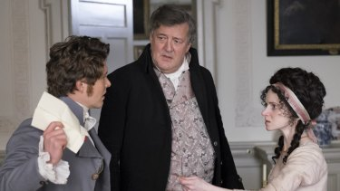 Stephen Fry (centre) as a pompous husband with Xavier Samuel and Jenn Murray in <i>Love & Friendship</i>.