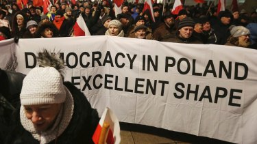 Supporters of the ruling Law and Justice party  at a pro-government rally in front of the presidential palace, in Warsaw, Poland.