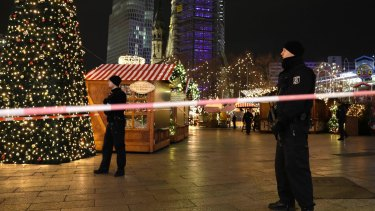 Police guard a Christmas market in Berlin after a truck ploughed into the crowd.